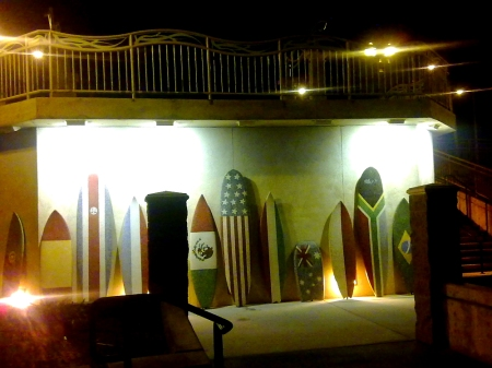 surf boards with flags