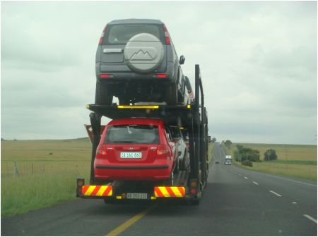 The upside: Cars don't have to sit behind you on a single lane highway for 3kms. Downside? It's illegal? Upside? Nobody cares.